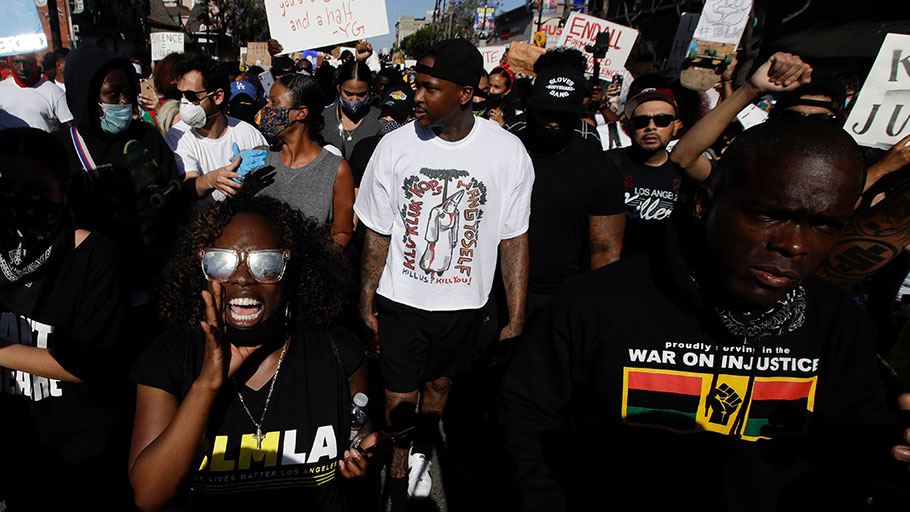 Rapper YG, center in white, at a June 7 protest over the death of George Floyd.