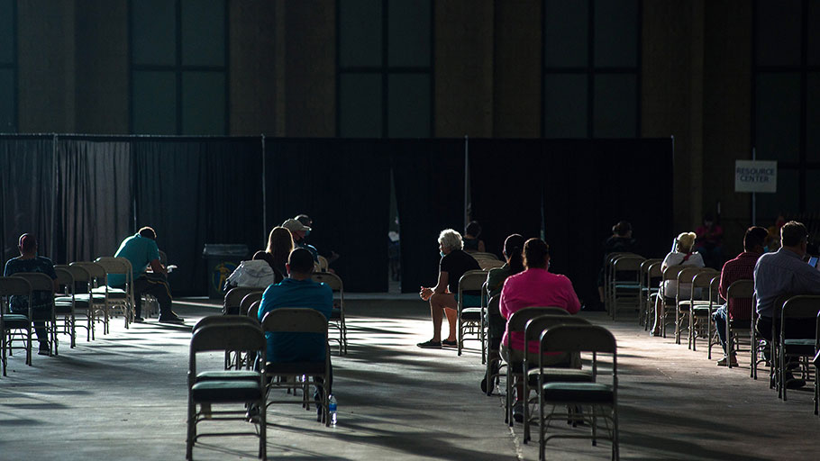 People await help with unemployment claims at an event in Tulsa, Okla., on July 24.