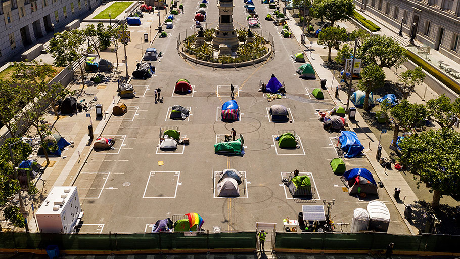 Rectangles designed to help prevent the spread of the coronavirus by encouraging social distancing line a city-sanctioned homeless encampment at San Francisco's Civic Center on May 21