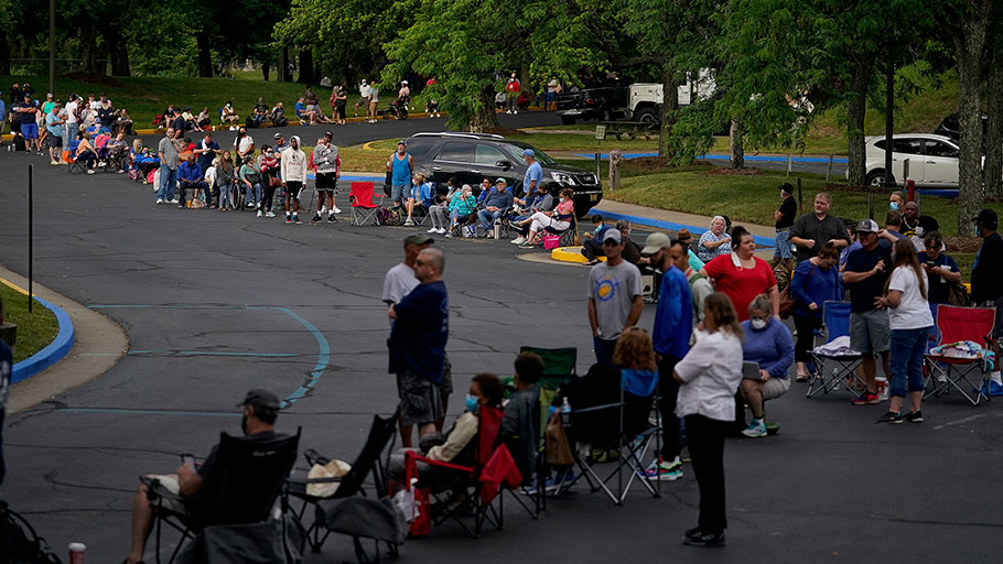 People line up outside Kentucky Career Center to find assistance with their unemployment claims in Frankfort, Kentucky, U.S. June 18.