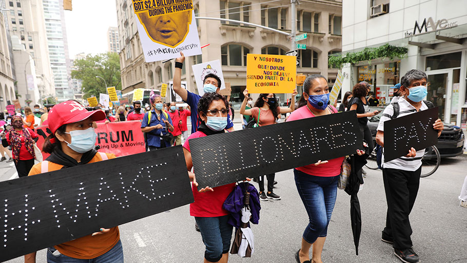 "People participate in a ""March on Billionaires"" event on July 17 in New York City."