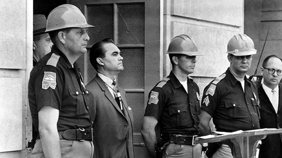 George Wallace blocking a federal agent from entering the University of Alabama to enroll Black students, 1963.