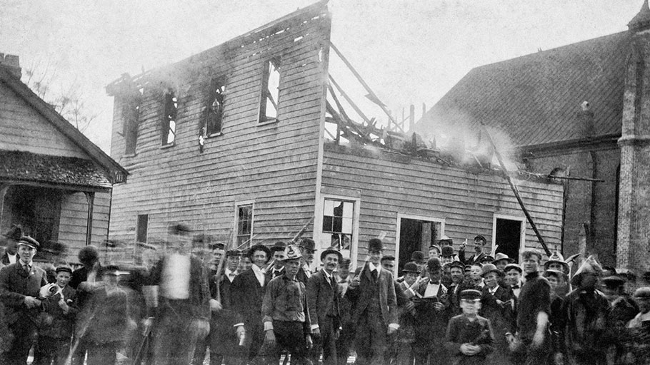 A mob of white men posing in front of the office of the black-owned Daily Record newspaper after burning it down, Wilmington, North Carolina, November 10, 1898