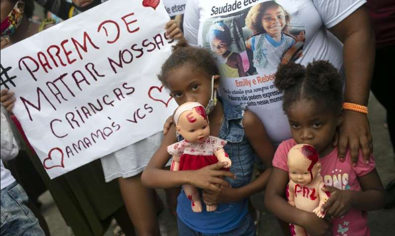 Stop-killing-our-children-portuguese-brazil-protest-910x512