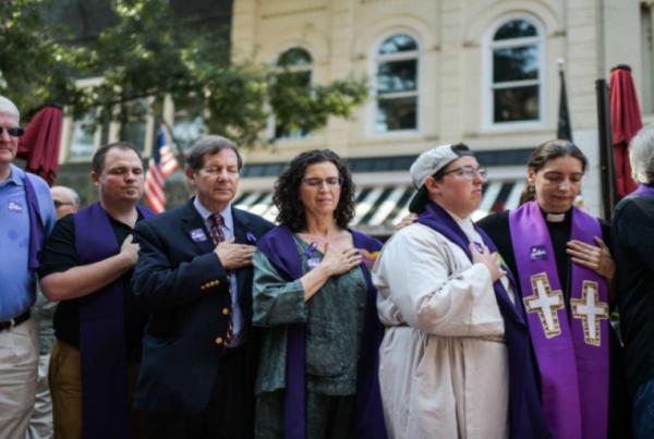 clergy-praying-vigil-white-violence-910x512
