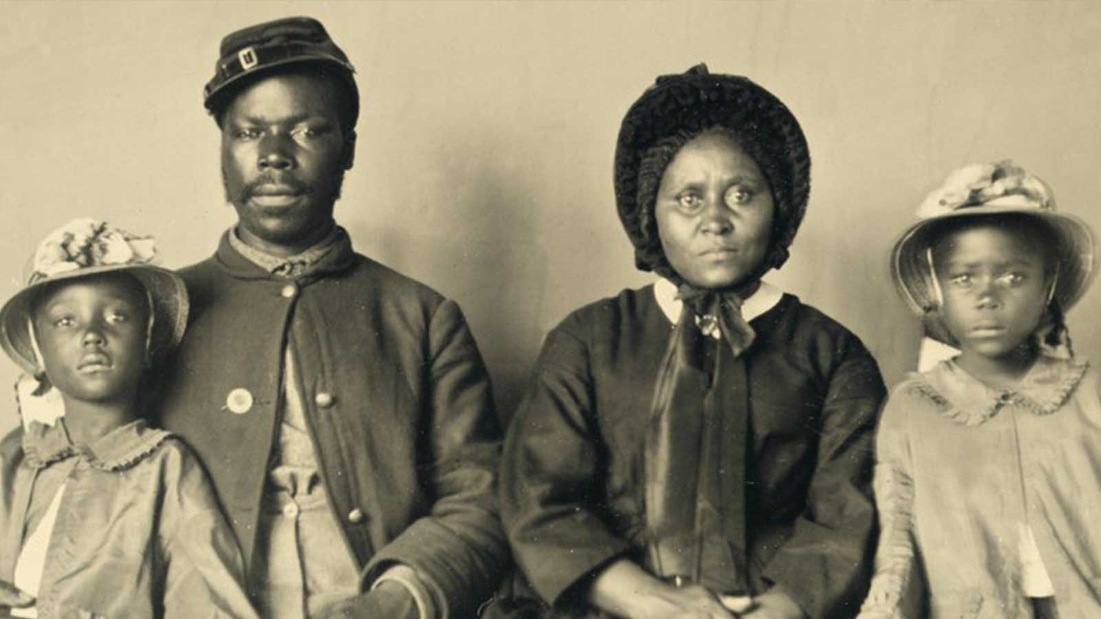 A Black Union soldier with his wife and two daughters taken in 1863
