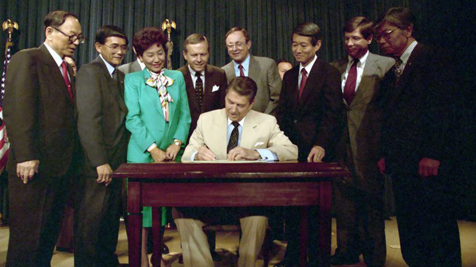 President Reagan signing a reparations bill in 1987 for Japanese-Americans interned during World War Two