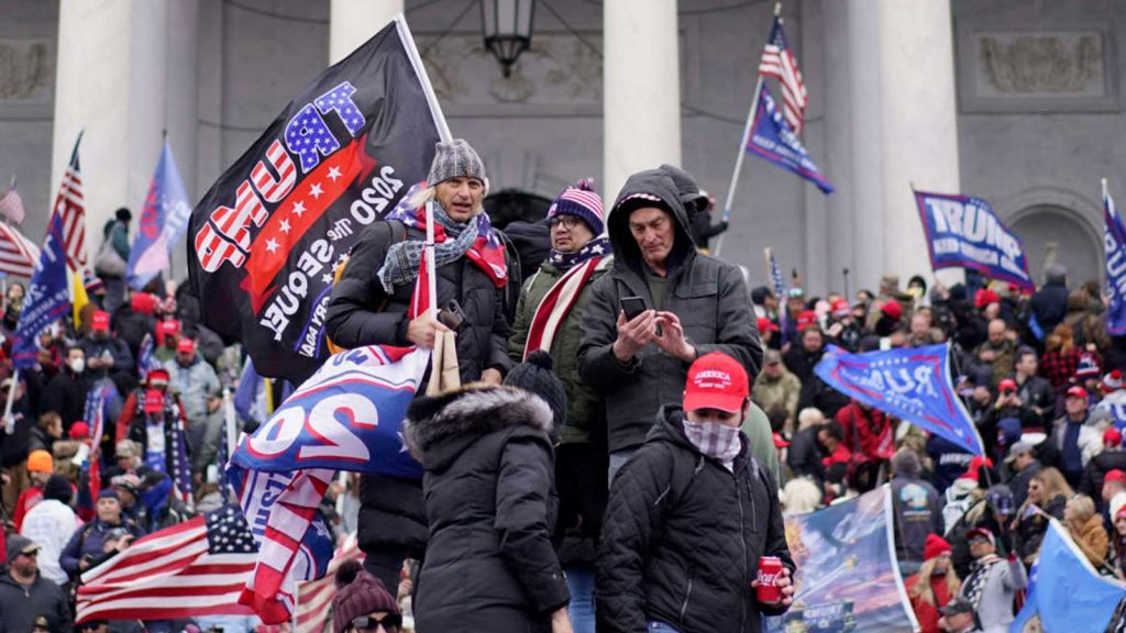 Trump loyalists storm the Capitol and halt a joint session of the 117th Congress on January 6, 2021, in Washington, D.C.