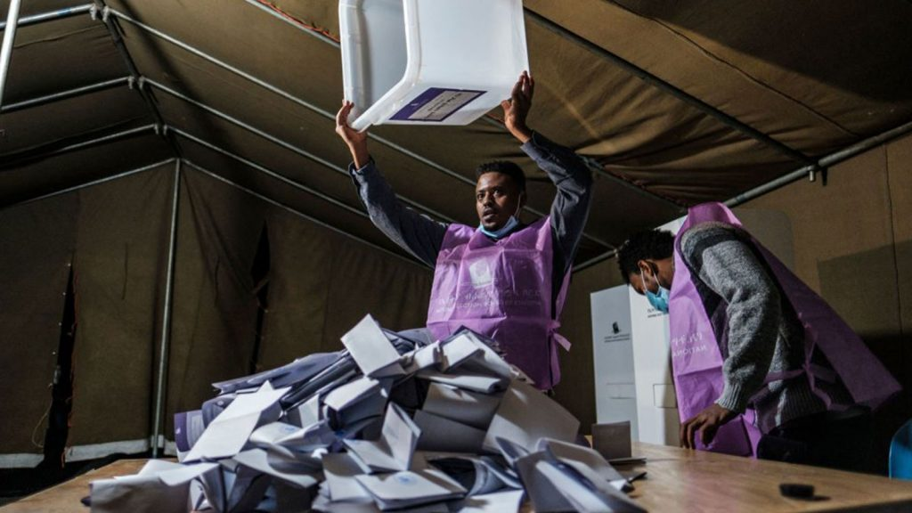 An electoral official with an empty ballot box after the closing of the polls in the city of Bahir Dar, Ethiopia on June 21, 2021.