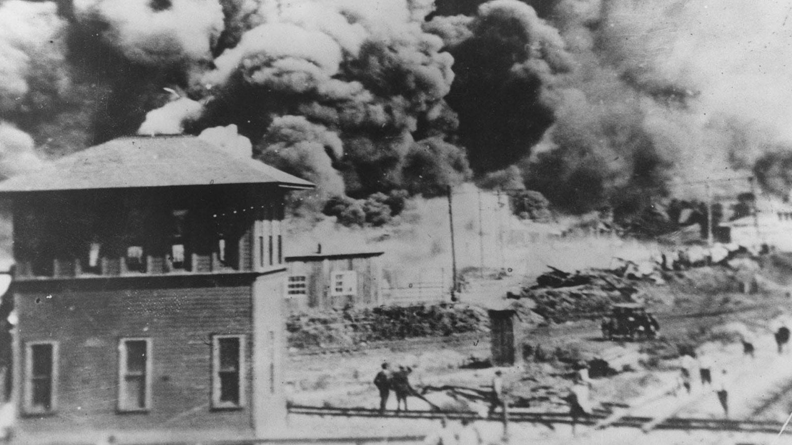 Smoke rises north of Greenwood Avenue from Hartford Avenue, in Tulsa, Okla. on June 1, 1921.