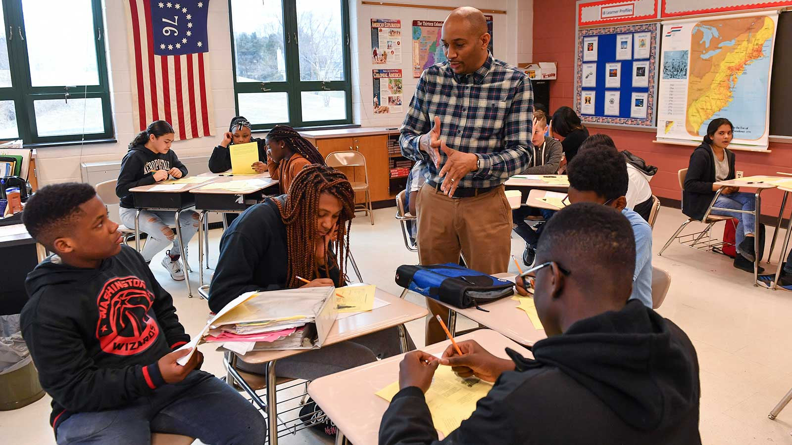 History teacher Philip Jackson teaches the history of slavery to his eighth-graders
