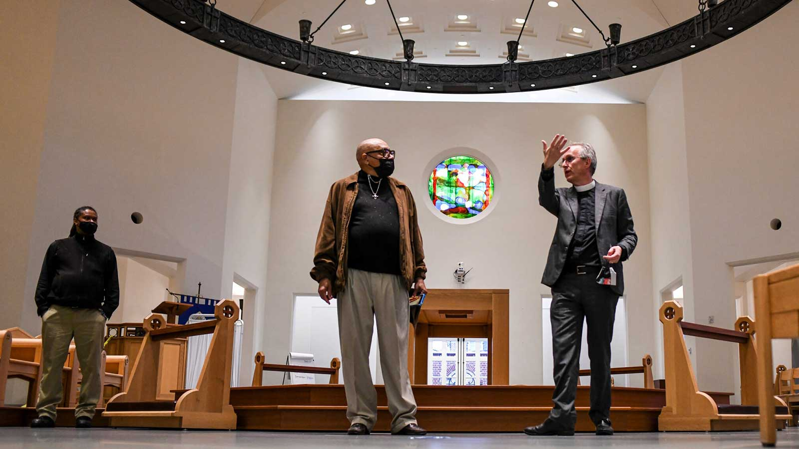 The Rev. Ian S. Markham, right, gives Gerald Wanzer a tour of the seminary campus