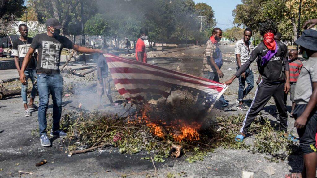American flag burning in Haiti