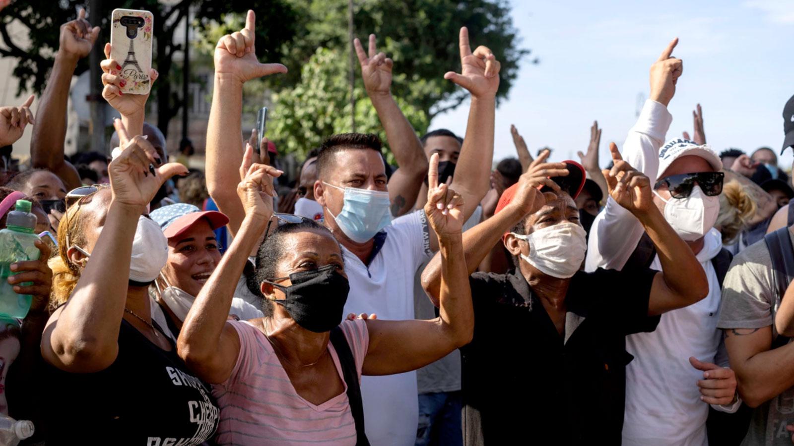 Anti-government protesters march in Havana l