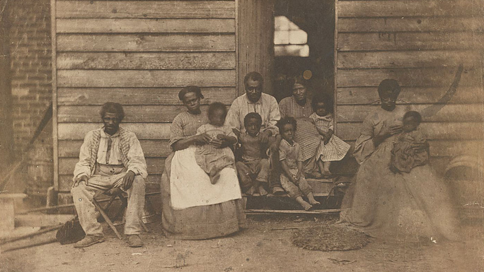 An enslaved African American family or families pose on the plantation of Dr. William F. Gaines in Hanover County, Virginia, 1862.
