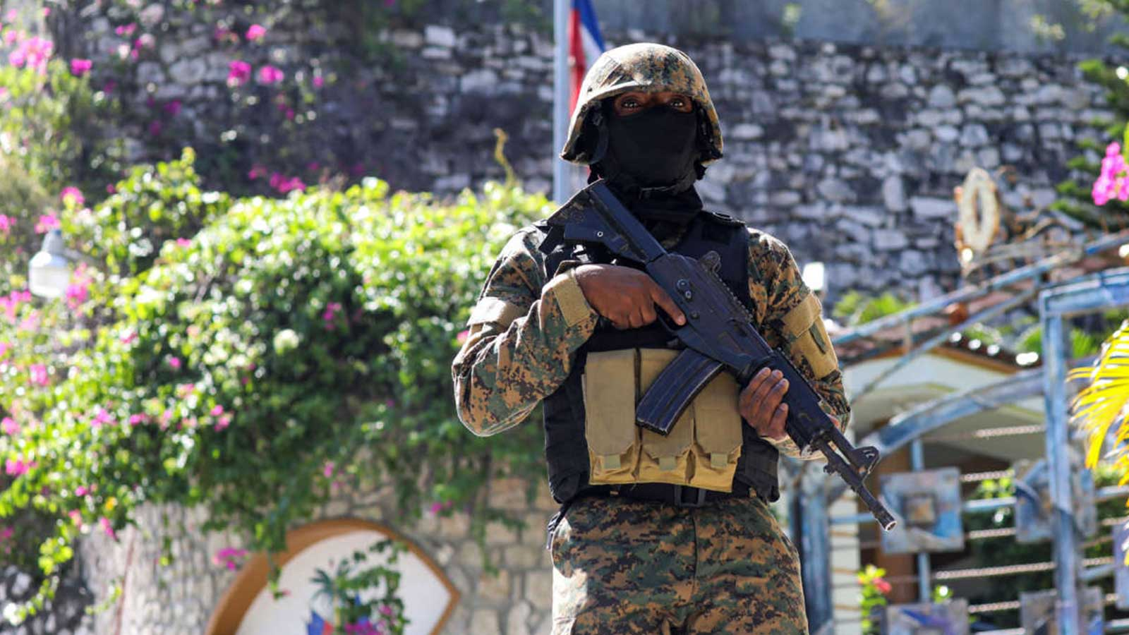 Haitian police patrol outside the presidential residence in Port-au-Prince