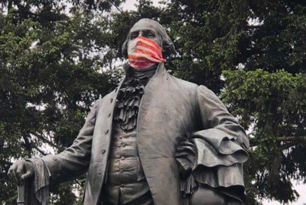 Masked George Washington statue.