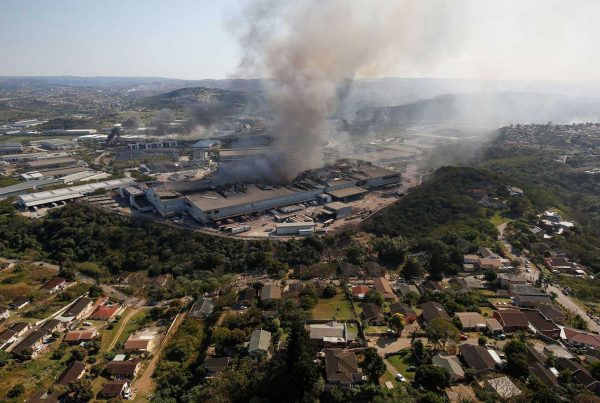 A warehouse smolders in Durban, South Africa, after supporters of former President Jacob Zuma erupted in violence earlier this month when Zuma was jailed.