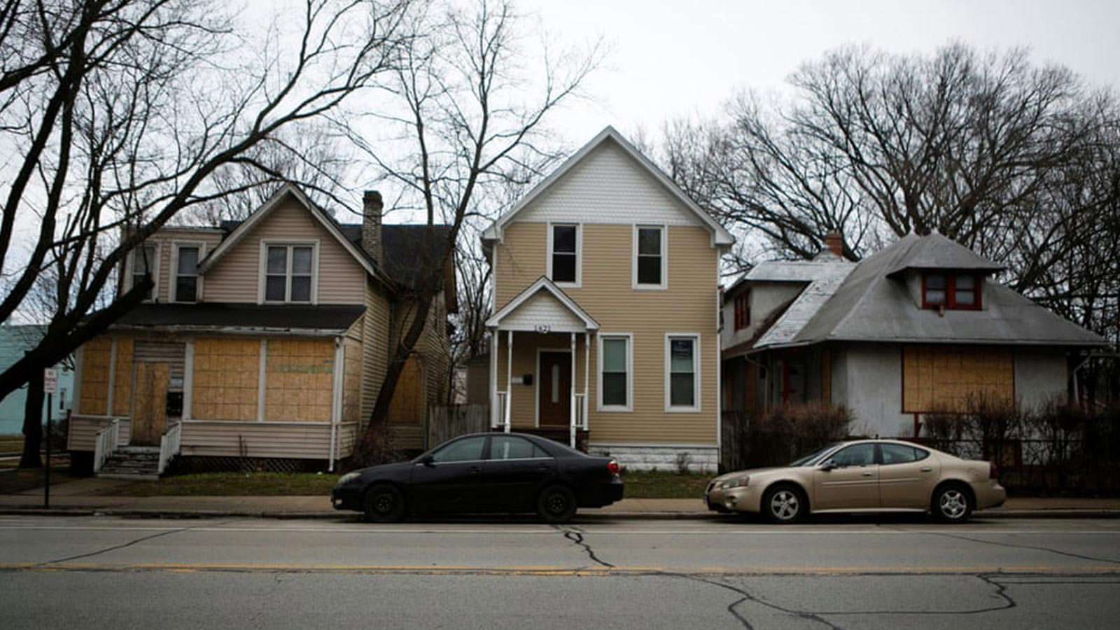 Boarded-up houses are seen in the Fifth Ward in March.