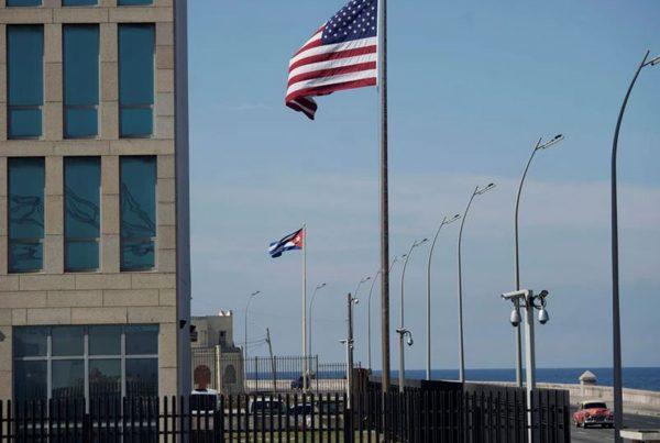 A view of Cuban and U.S. flags beside the U.S. Embassy in Havana, Cuba, December 15, 2020.