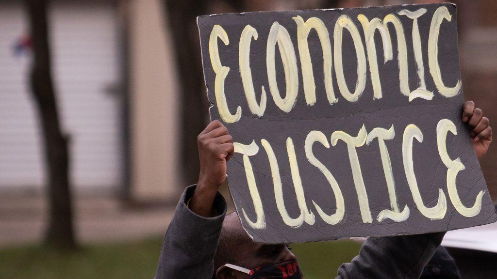"""""""Economic Justice"""" sign"""