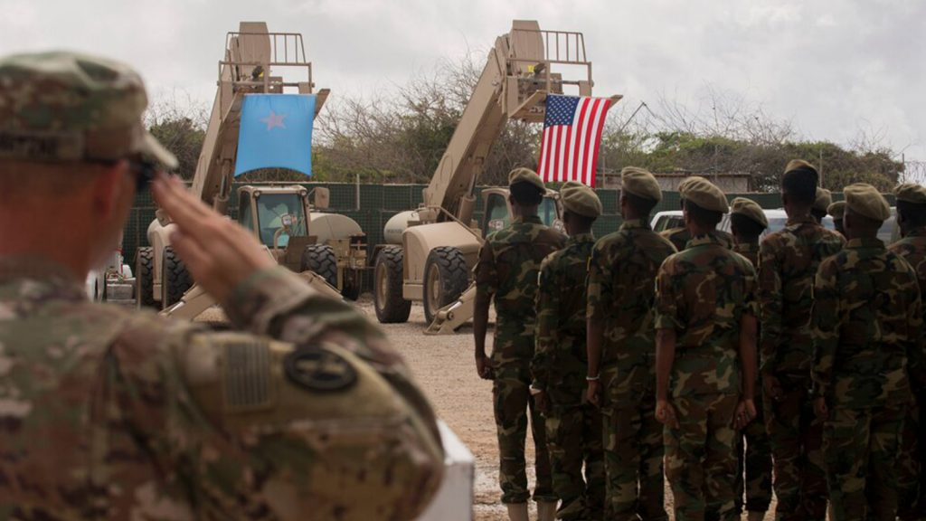 Somali national army soldiers stand in formation during a logistics course graduation ceremony following 14 weeks training with the U.S. 10th Mountain division.
