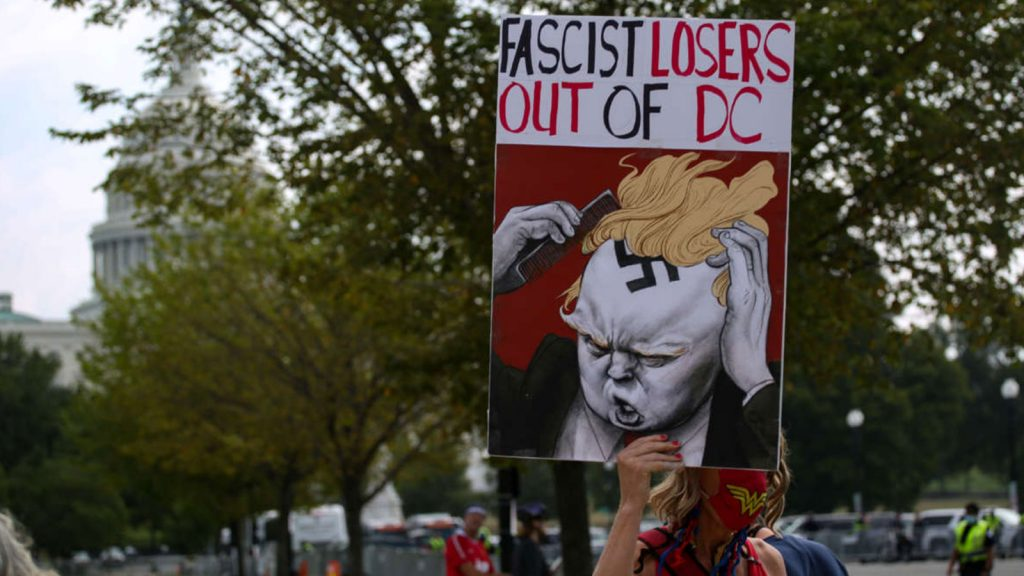 """Counterprotestors demonstrate in Washington, D.C., on September 18, 2021, against the """"Justice for J6"""" rally supporting those arrested during the January 6 coup attempt."""