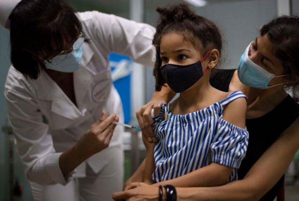 A girl gets a dose of the Cuban made Soberana-02 vaccine for COVID-19 in Havana, Cuba, Tuesday, Aug. 24, 2021.