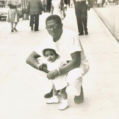 Dr. Garvey with daughter, Nzinga Garvey, in front of Harlem Hospital Center.