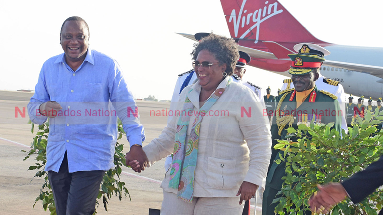 Prime Minister Mia Mottley and Kenyan president Uhuru Kenyatta holding hands before he left the island after a three-day official visit in 2019.