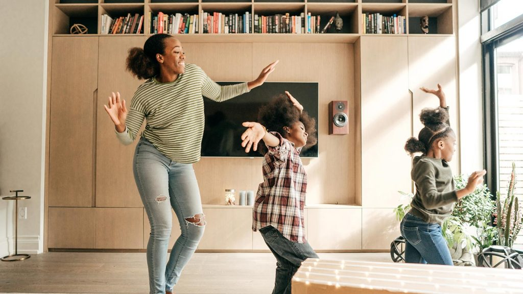 Mom dancing with daughters